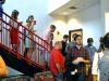 Former Red & Black staff members return from the newsroom immediately before the first statement began at an open house at The Red & Black on Friday. Photo by Porter McLeod.