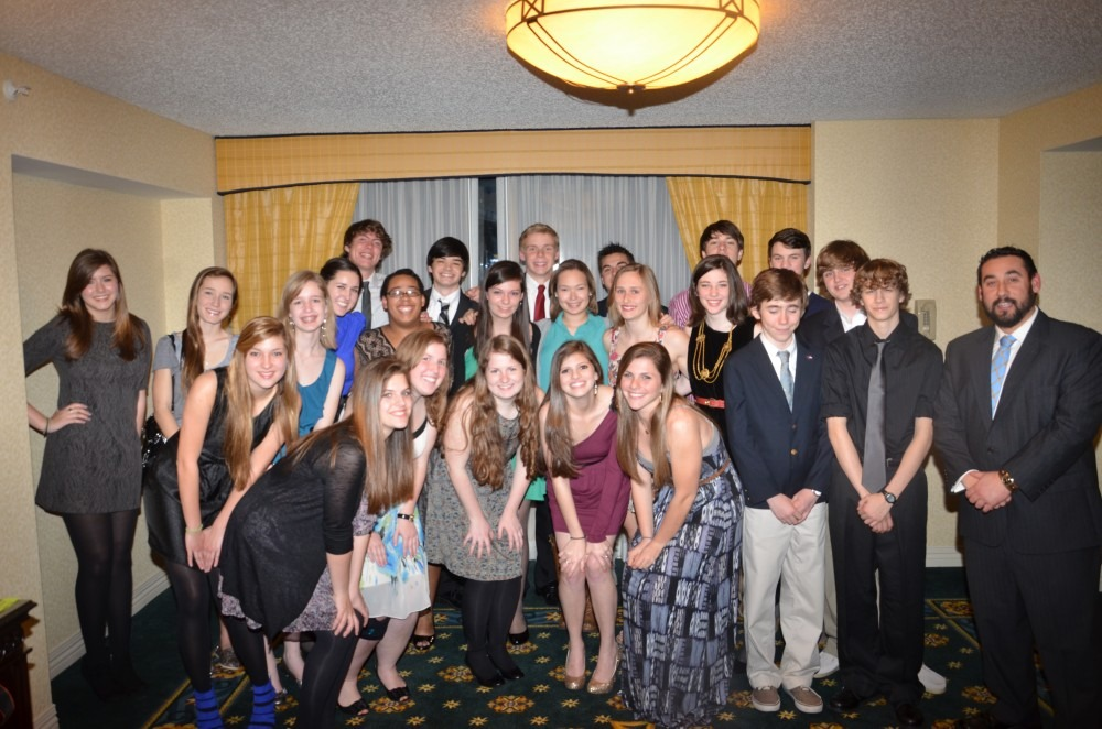 The ODYSSEY staff poses for a group photo on the last night of the convention. Photo by Gabrielle Saupe.